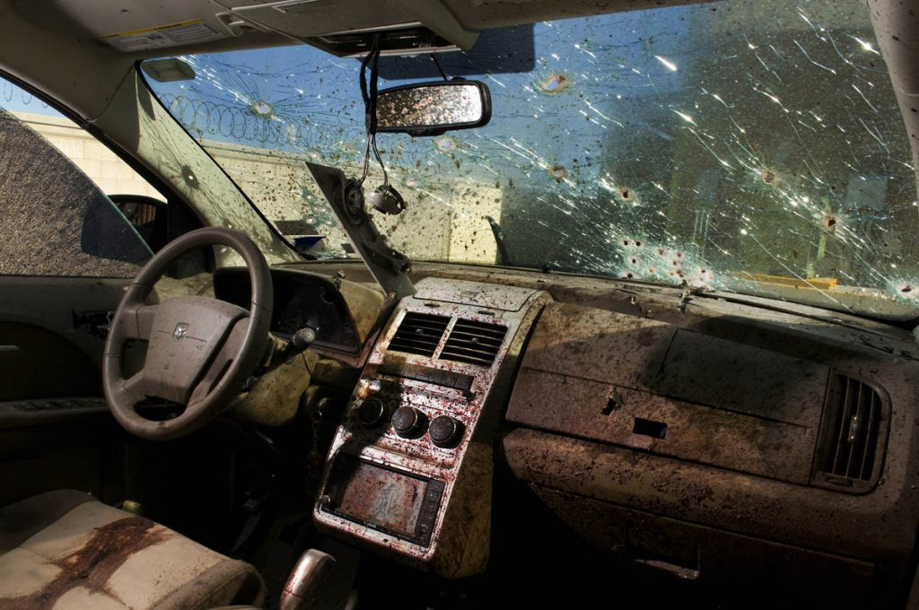 JUAREZ, MEXICO: DEC. 17, 2008 - Inside the car where a man and a woman were gunned down by assassins. The death industry is booming in the city of Juarez. Since Mexican President Felipi Calderon launched a 'war on drugs' at the start of 2007 Mexico has seen nothing but bloodshed -- the number of murders has quadrupled in Juarez and doubled across the country -- With approx. 1,600 deaths in 2008, Jaurez is now the deadliest city in the world, per capita. (Photo by Shaul Schwarz Reportage/Getty)